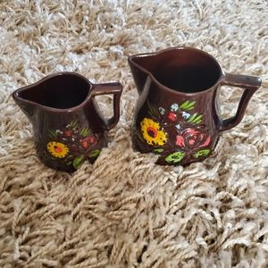 Brown pottery pitchers floral pattern flowers